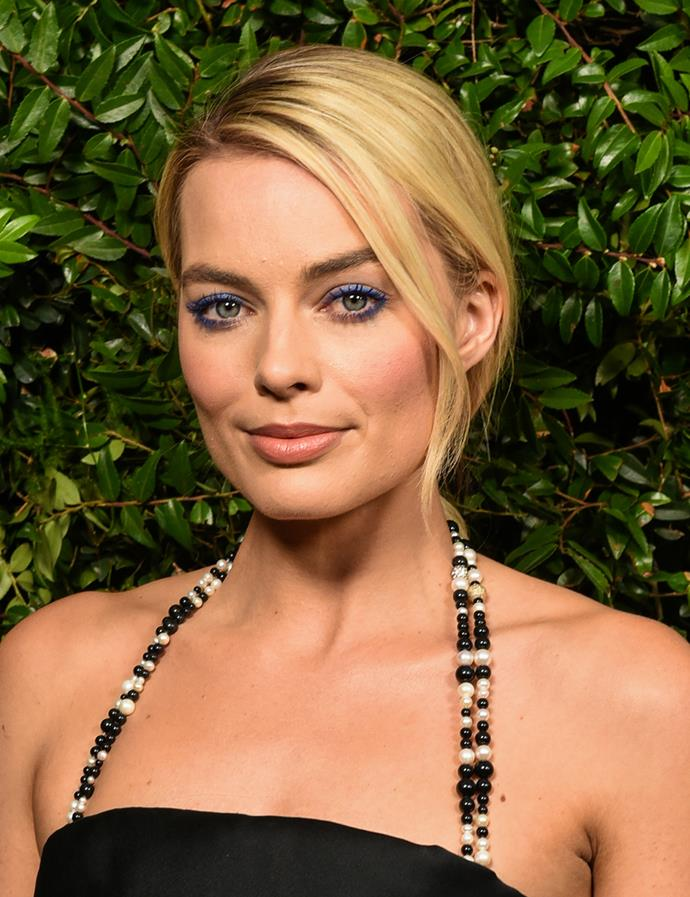 Pulled back in a simple low updo. <br><br> Margot pictured at a pre-Oscars party in March 2018.