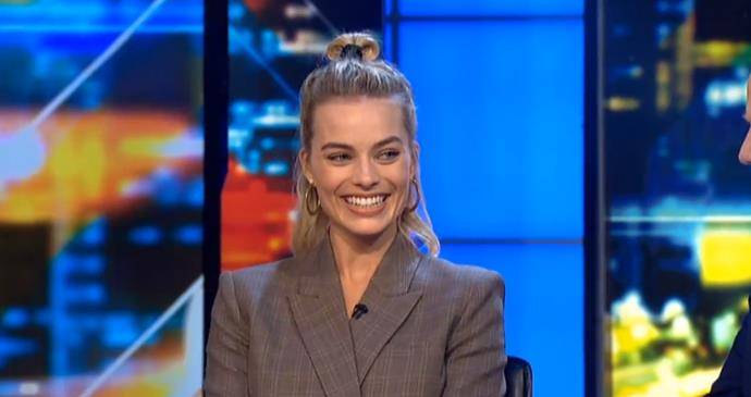 In a looped half-top knot secured with a ribbon. <br><br> Margot pictured on *The Project* in January 2018.