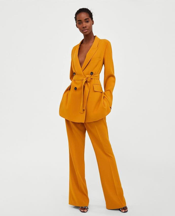 "Suit jacket, [$179](https://www.zara.com/au/en/long-belted-jacket-p07245778.html?v1=5710521&v2=1010155|target=""_blank""|rel=""nofollow""). Trousers no longer available. Shop similar [$99](https://www.zara.com/au/en/pleated-trousers-with-buttons-p07149063.html?v1=5666193&v2=1010044|target=""_blank""|rel=""nofollow"") at Zara."