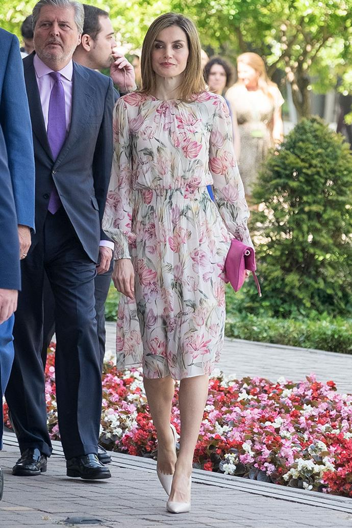 Letizia was spotted wearing another floral Zara day dress for an official appearance in Madrid, which she paired with neutral pumps and a matching fuschia clutch.