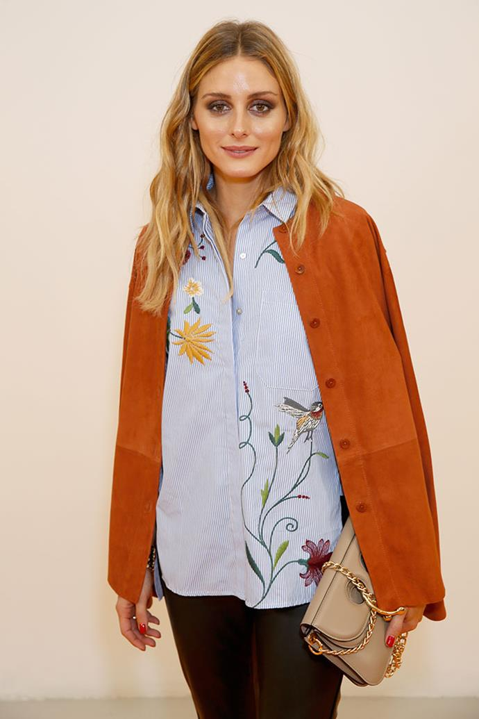 Olivia's embroidered floral shirt is perhaps one of the most famous Zara pieces of all time, making multiple appearances during the one fashion week.