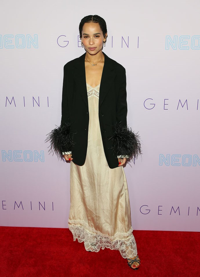 Zoë Kravitz put the ultimate cool-girl spin on a Gucci slip dress by layering it under a feathered Prada blazer.