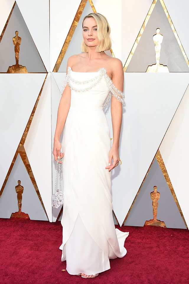Margot Robbie was announced as a new ambassador for Chanel shortly before she hit the red carpet at the 2018 Oscars, so naturally she was dressed in Chanel Couture. The while gown with off-the-shoulder trim was designed by Karl Lagerfeld.