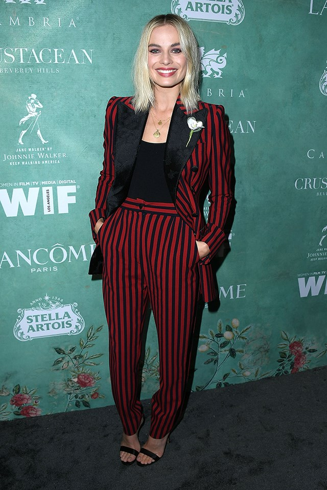 For the Women in Film Oscar nominees celebration, Margot Robbie wore a red and black striped suit by Dolce & Gabbana.