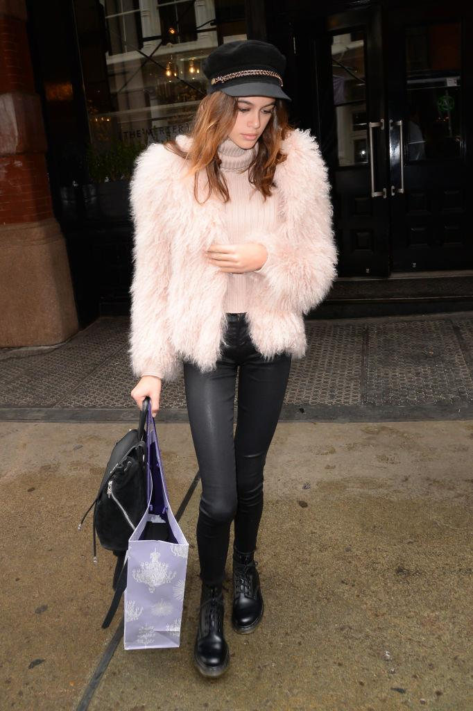 **Kaia Gerber** in millennial pink faux fur.