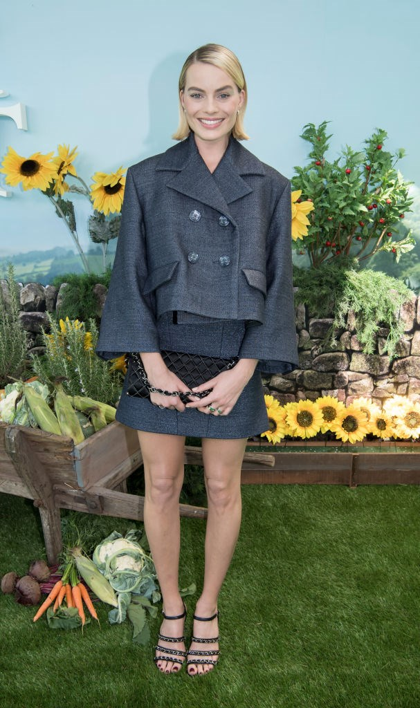 **Margot Robbie** in a boxy oversized cropped chanel jacket.