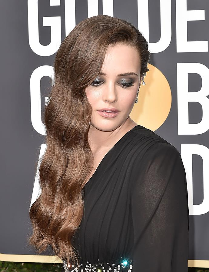 Wearing a metallic smokey eye and deep side part at the Golden Globes in January 2018.