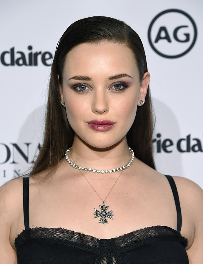 With slicked back hair and a berry lip at an event in January 2018.
