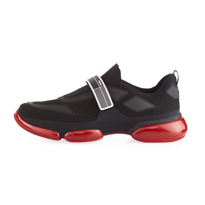 "Cloudbust Knit Sport Sneaker, $905, Prada at [Bergdorf Goodman](https://www.bergdorfgoodman.com/Prada-Cloudbust-Knit-Sport-Sneaker-with-Single-Grip-Strap/prod136010016/p.prod?ecid=BGAF__Skimlinks.com&utm_medium=affiliate&utm_source=BGAF__Skimlinks.com|target=""_blank""