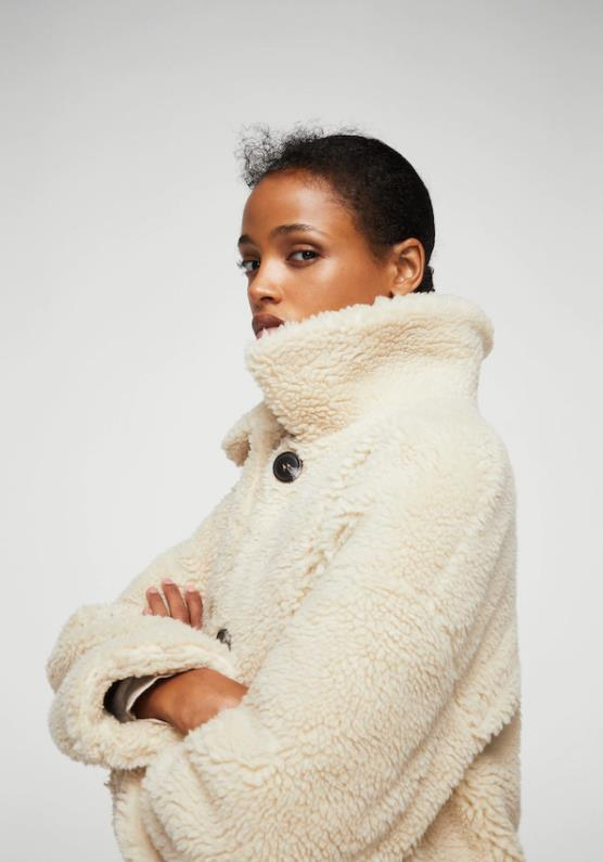 "Faux Shearling-Lined Coat, $119.99 from [Mango](https://shop.mango.com/us/women/coats/faux-shearling-lined-coat_13077017.html?utm_medium=affiliate&utm_source=7799179&utm_campaign=CJ|target=""_blank"")."