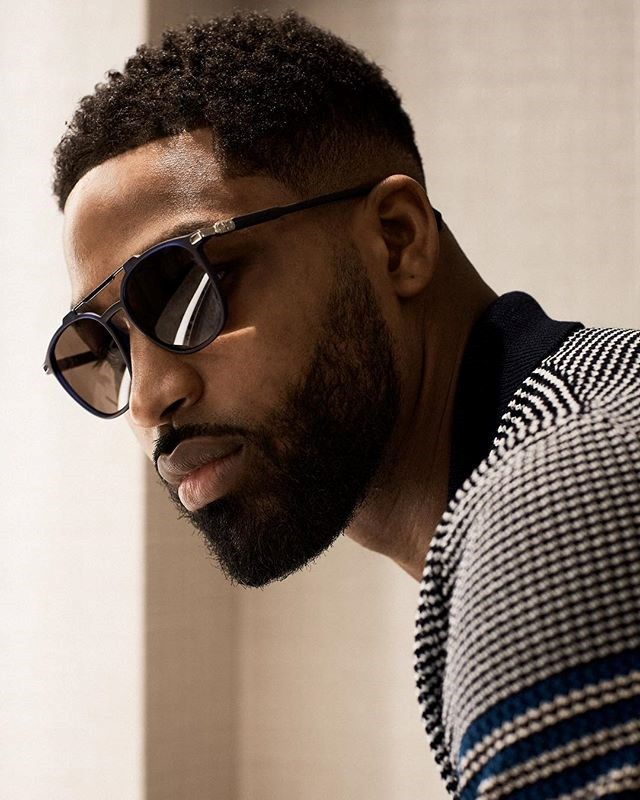 """Tristan Thompson himself has also (oddly) taken to Instagram to avoid the elephant in the room—sharing a picture of himself sporting a pair of sunglasses which he promotes in his caption. While he may have avoiding talking about Khloé, it seems that she is all anyone can talk about in the [comments of this picture](https://www.instagram.com/p/BhZjqDPA-0M/?taken-by=realtristan13 target=""""_blank"""")."""