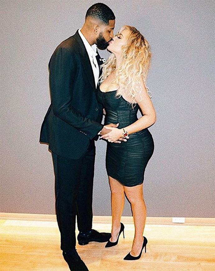 Khloé Kardashian and Tristan Thompson kissing in front of the camera. (Sourced from Instagram.)