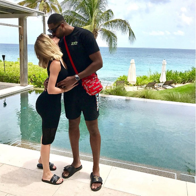 Khloé Kardashian and Tristan Thompson kissing poolside. (Sourced from Instagram.)