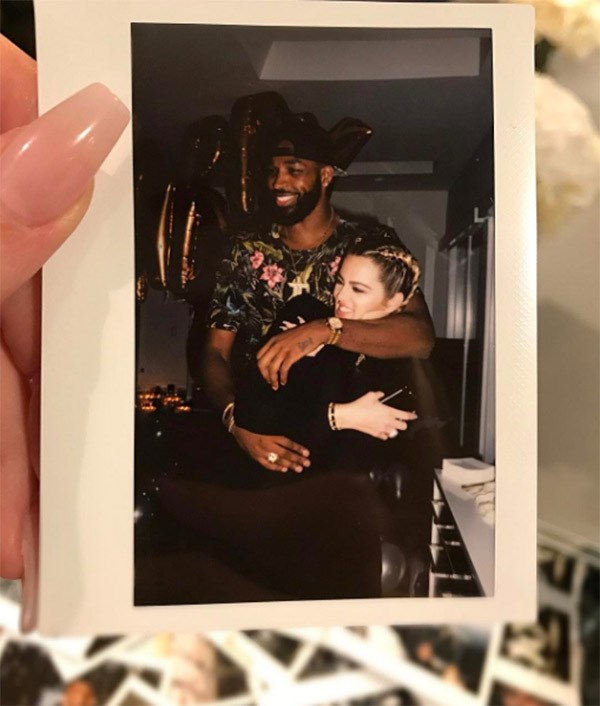 Khloé Kardashian and Tristan Thompson cuddling up to each other in a Polaroid. (Sourced from Instagram.)