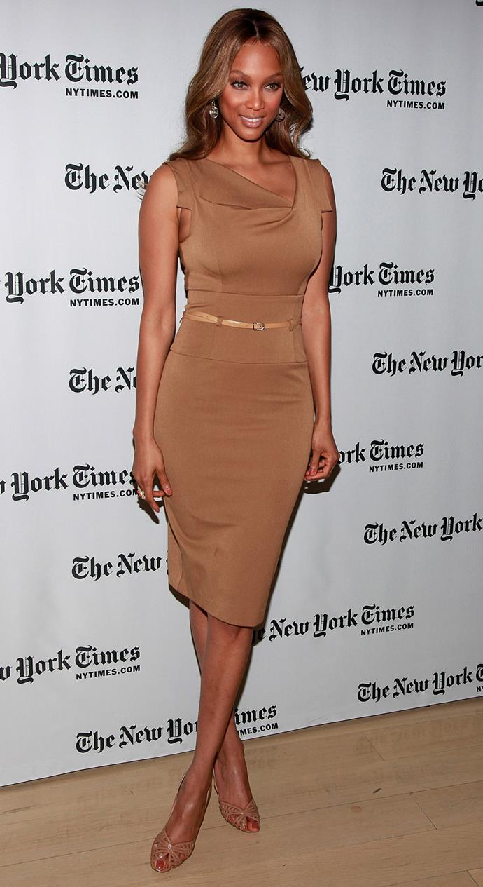 Tyra Banks in the Black Halo Jackie O Dress at a New York Times Event in 2009.