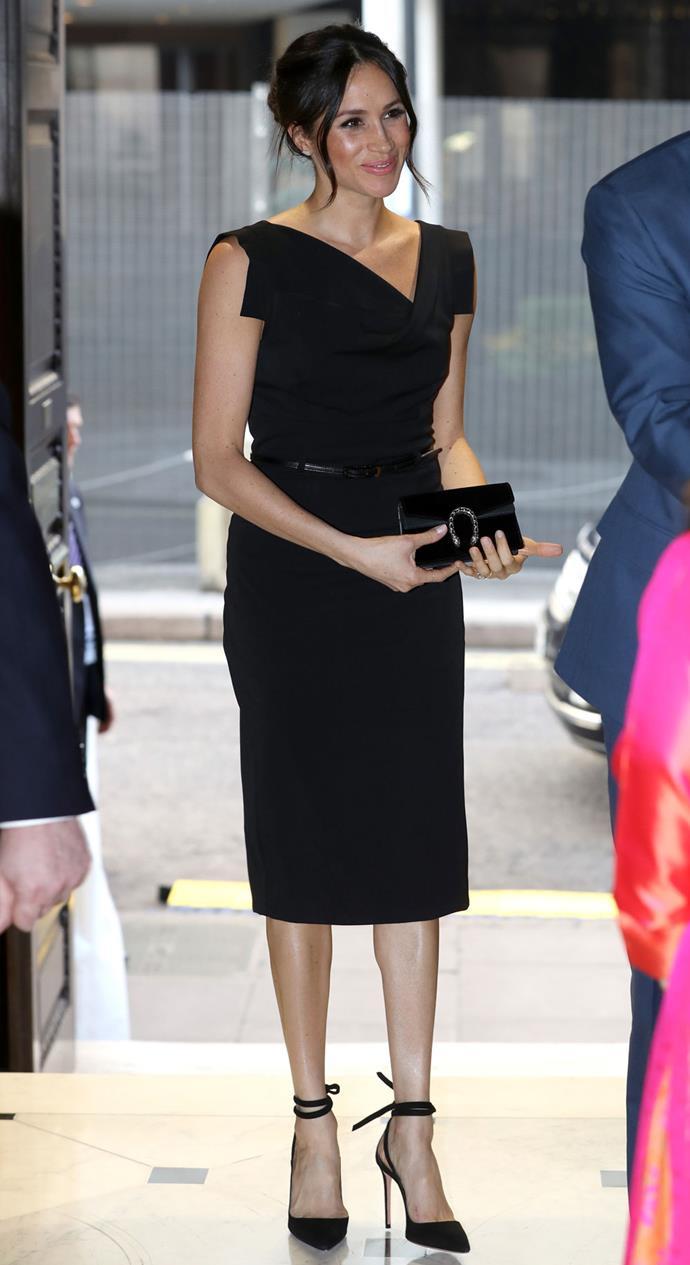Meghan Makrle in the Black Halo Jackie O Dress in 2018.
