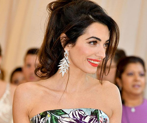 **Amal Clooney** <br> Met Gala host Amal Clooney found the *perfect* shade of red lipstick for her skin tone.