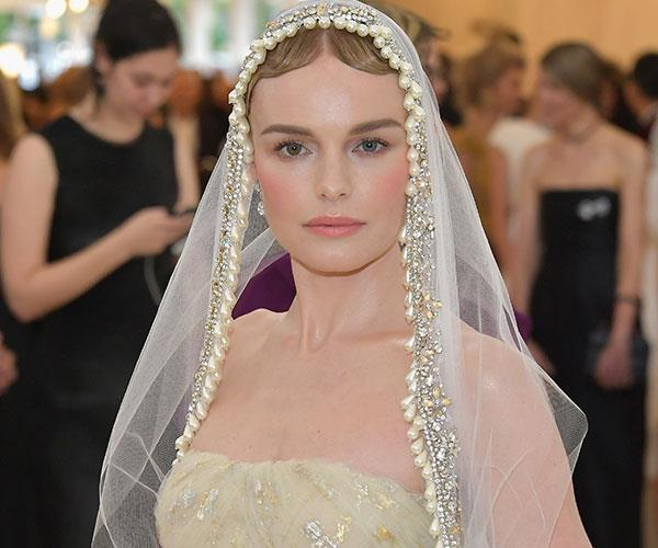 **Kate Bosworth** <br> With a veil, slicked down hair and peachy blush, Kate Bosworth looked like a walking doll.