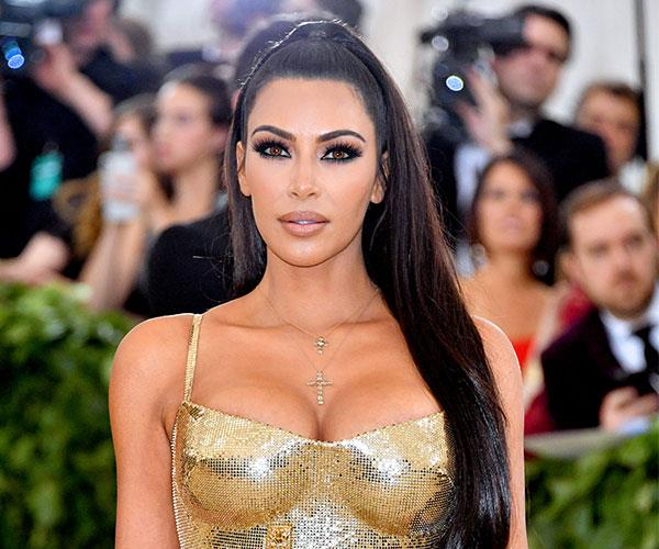 **Kim Kardashian** <br> By opting for a sleek high pony, Kim Kardashian let her smokey eye do the talking.