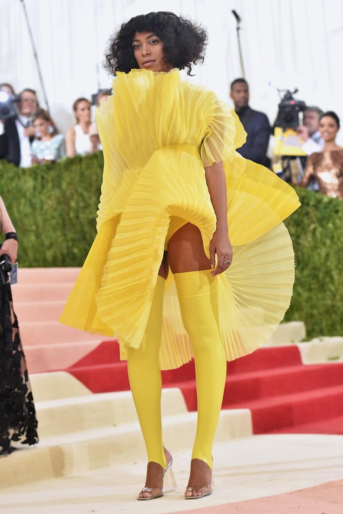 **2016: SOLANGE in David Laport** <br><br> There's nobody that shuts down the Met carpet quite like Solange; and 2016's lemon-yellow sartorial display by David Laport was no exception.  <br><br> Arriving separately from her Givenchy-clad sister Beyoncé, Solange made sure every lens was on her cupcake case-reminiscent ensemble, and spawned *Big Bird* memes aplenty.