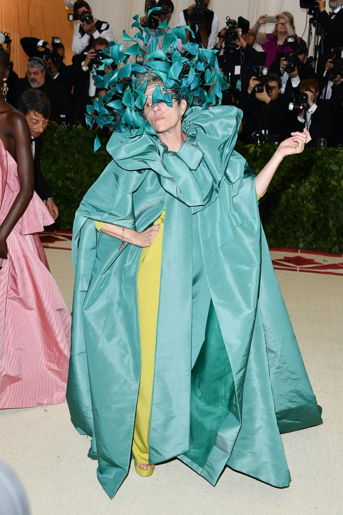"""**2018: FRANCES MCDORMAND in Valentino Couture** <br><br> The term 'fashion idol' isn't the first that springs to mind when discussing two-time Academy Award-winner Frances McDormand, but she ventured to prove otherwise at yesterday's Met Gala.  <br><br> Arriving in an ethereal Valentino Couture gown and headpiece (and a significant """"*I'm having so much fun parodying the absolute sh-t out of these fashion people*"""" look on her face), McDormand's IDGAF attitude was on full display—and, by all means, she stole the show."""