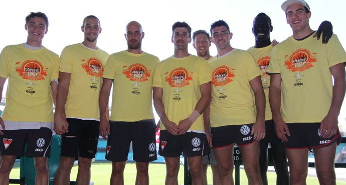 *Darkness Into Light* Sydney ambassador, Tadhg Kennelly (third from left) alongside Swannies (L-R) Will Hayward, Sam Reid, Robbie Fox, Jeremy Laidler, Colin O'Riordan, Aliir Aliir and Tom McCartin all sporting the iconic yellow DIL shirts for the not-to-be-missed walk in Bondi in aid of suicide prevention.