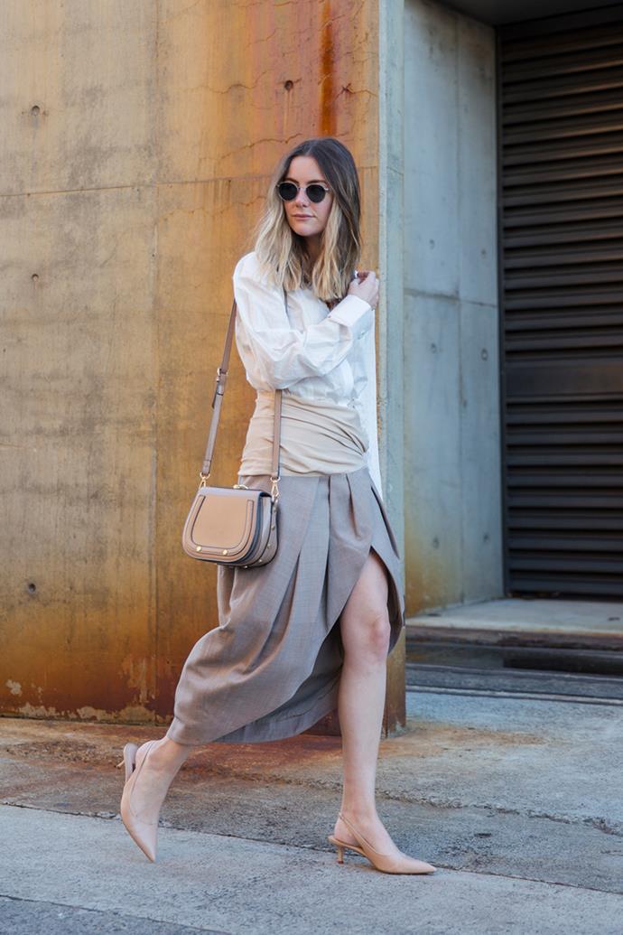 "**Natasha Harding—Digital Fashion Writer** <br><br> Dress: Jacquemus, at [Shopbop](https://www.shopbop.com/melao-dress-jacquemus/vp/v=1/1572394926.htm?folderID=27494&fm=other-shopbysize-viewall&os=false&colorId=12688 target=""_blank"" rel=""nofollow"") <br><br> Shoes: [Zara](https://www.zara.com/au/en/leather-backless-high-heel-shoes-p12918901.html?v1=6110501&v2=1010069 target=""_blank"" rel=""nofollow"") <br><br> Sunglasses: Bailey Nelson"