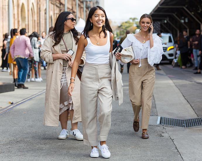 **Dannielle Cartisano—Bookings & Style Editor** <br><br> Trench: Topshop <br><br> Top: Acne <br><br> Skirt: Lee Mathews <br><br> Sneakers: Veja <br><br> Sunglasses: Bec & Bridge x Pared Eyewear <br><br> **Claudia Jukic—Market Editor** <br><br> Top: Thierry Colson <br><br> Trousers: Topshop <br><br> Bag: Miu Miu  <br><br> Loafers: Gucci