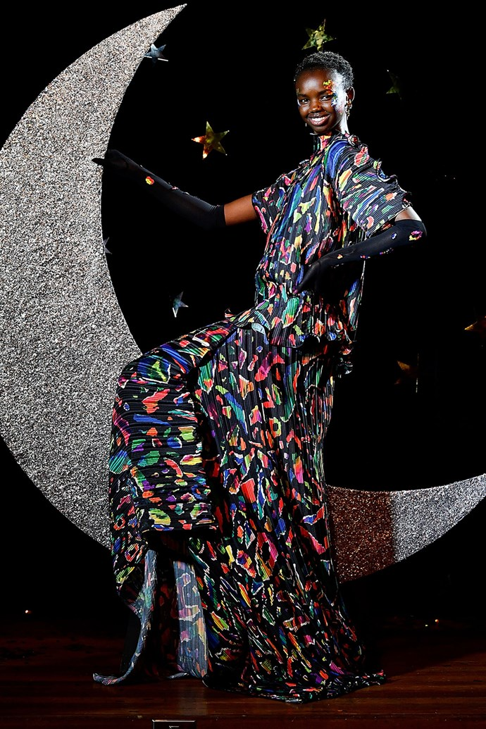 **Romance Was Born** <br><br> **Why everyone was talking about it:** The Romance Was Born show was one big party. Each model was transformed into a starry-eyed wild child, with an outfit to match. This '80s, technicolour maxi typifies everything that's right about the maximalist movement.
