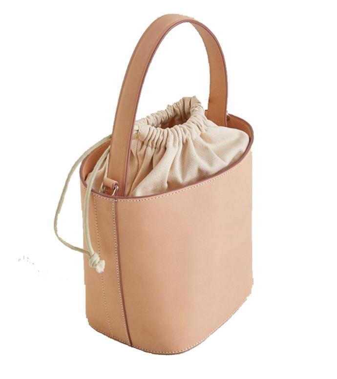 "Bag, $180 at [Mango](https://shop.mango.com/au/women/bags-shoulder-bags/leather-bucket-bag_33050668.html?c=08&n=1&s=accesorios.accesorio;40,340,440|target=""_blank""|rel=""nofollow"")"