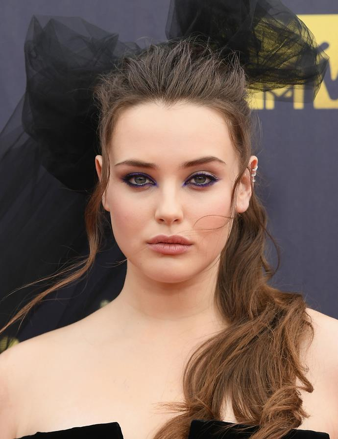 Wearing graphic purple eyeliner, flushes cheeks and a gorgeous giant tulle bow at the 2018 MTV Movie And TV Awards in June 2018.