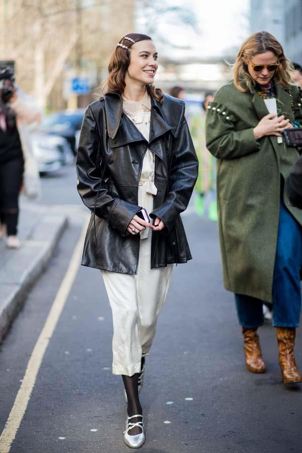 **The vinyl trench** <br><br> Vinyl trench coats have longevity, thanks to the simple fact that a minimalist black trench — of any texture — is one degree away from 'timeless'. Do like Alexa and pair with a pretty slip dress, tights and embellished flats.