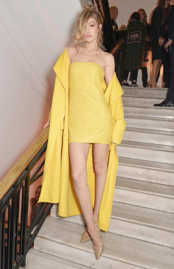 ***Go golden***<br> Worried about your tiny yellow mini dress with matching coat coming off too much? Take a leaf out of Gigi's book and pair with golden pumps and golden tresses.