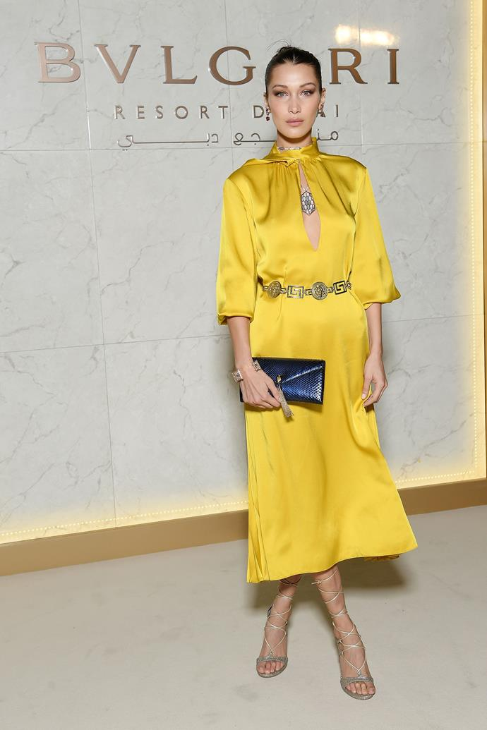 ***Add a little blue***<br> The risk of looking like a Swedish flag aside, Bella shows the power of pairing up her buttercup-yellow gown with a deep blue clutch.