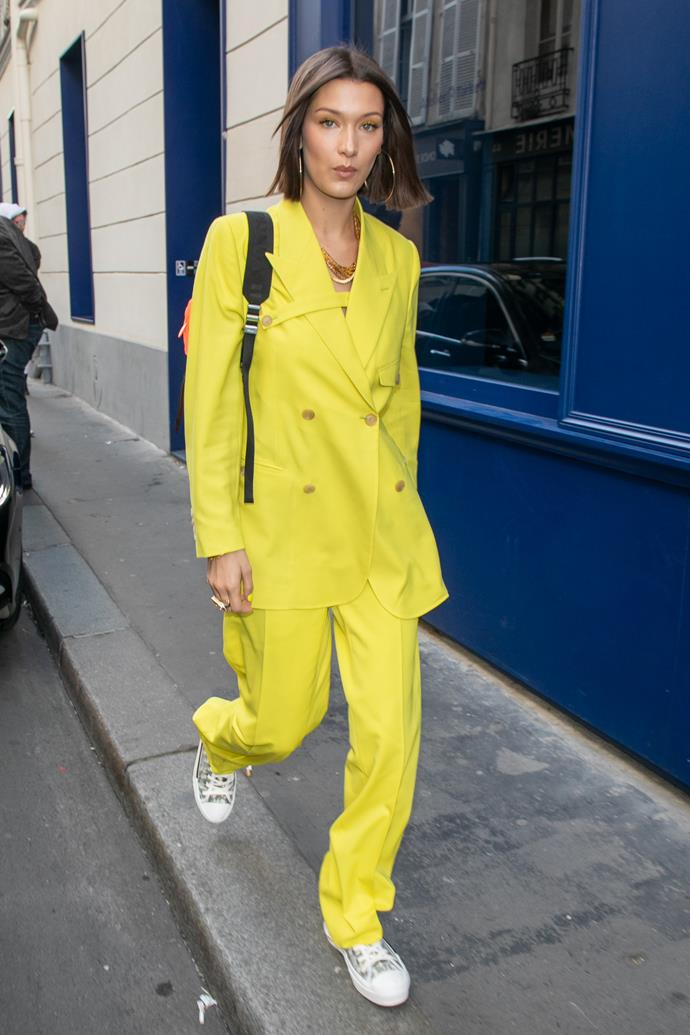 ***Tame it with sneakers***<br> Although we love a pair of sky-high heels as much as the next girl, Bella's choice of silver sneakers with this bright neon yellow suit gives it the sense of je ne sais quoi that a bright neon yellow suit needed.
