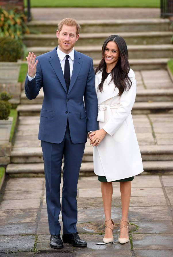Announcing her engagement to Prince Harry, wearing a coat by Line the Label, Aquazurra heels and a dress by Parosh, November 2017.