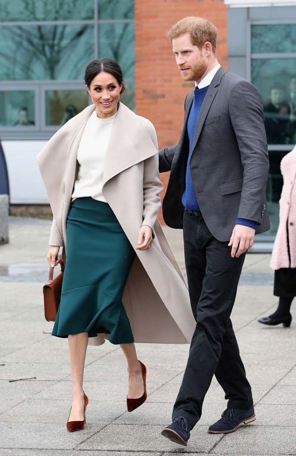 In a wool coat by Mackage, a Victoria Beckham sweater and Jimmy Choo pumps during a visit to Belfast, March 2018.
