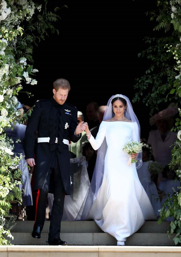 In Givenchy at her wedding to Prince Harry, May 2018.