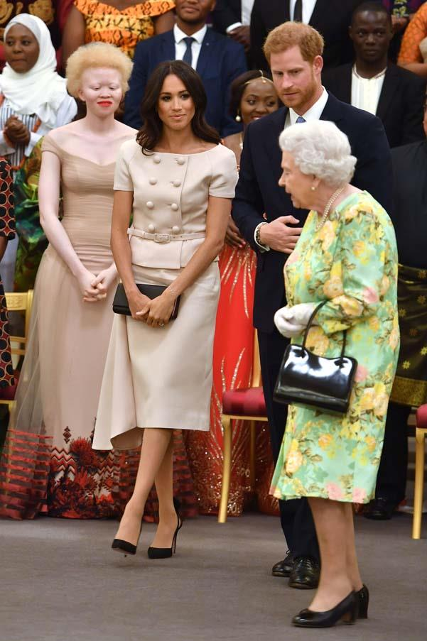 In Prada at the Queen's Young Leaders Award at Buckingham Palace, June 2018.