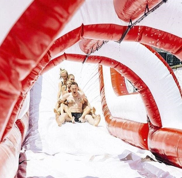 2016: Swift's then-boyfriend Tom Hiddleston came along too and took part in the inflatable water slide fun. He was also photographed wearing a highly embarrassing 'I heart TS' singlet that ruined his street cred for years to come.