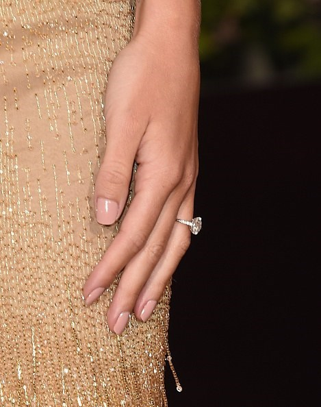 The classic design of Rosie Huntington-Whiteley's engagement ring from Jason Statham has the same sparkle as Hailey Baldwin's diamond.