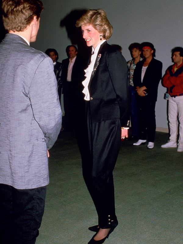 **DIANA, PRINCESS OF WALES** <br><br> When meeting Bryan Adams in 1986, Princess Diana wore an all-black suit by British designer Jasper Conran, paired with a frilled shirt.