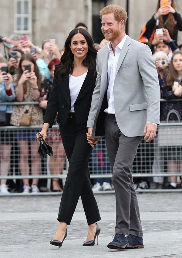 """**MEGHAN, DUCHESS OF SUSSEX** <br><br> While visiting Ireland in July 2018, the Duchess of Sussex wore a custom suit by Givenchy, paired with a matching Givenchy belt. Givenchy has proven to be one of Meghan's favourite designers, with the label's artistic director Clare Waight Keller creating her [highly anticipated wedding dress](https://www.elle.com.au/culture/meghan-markle-wedding-dress-details-17582 target=""""_blank"""")."""