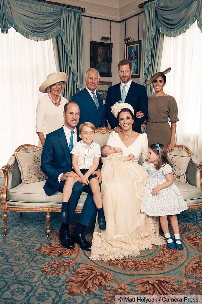 Prince Charles, Camilla, Prince Harry, Meghan Markle, Prince William, Kate Middleton, Prince Louis and Princess Charlotte smile for the camera.