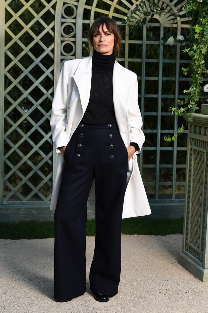 """***Turtleneck + messy bun = heaven***<br><br> We have already extolled the [versatility of the turtleneck](https://www.harpersbazaar.com.au/fashion/turtleneck-outfit-ideas-16835 target=""""_blank"""") as a winter staple, but pairing it with a messy bun (curtain bangs optional but encouraged) and a pair of tailored trousers like Caroline de Maigret takes it from boardroom to Le Marais."""