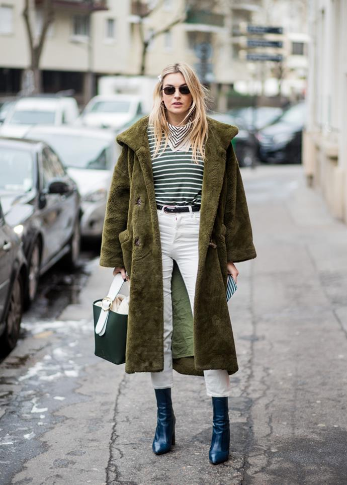 ***Go monochrome***<br><br> Although it usually is our go-to, black isn't the only colour that lends itself to monochrome. Take a leaf out of Camille Charriere's book and match your outfit accessories to your coat.