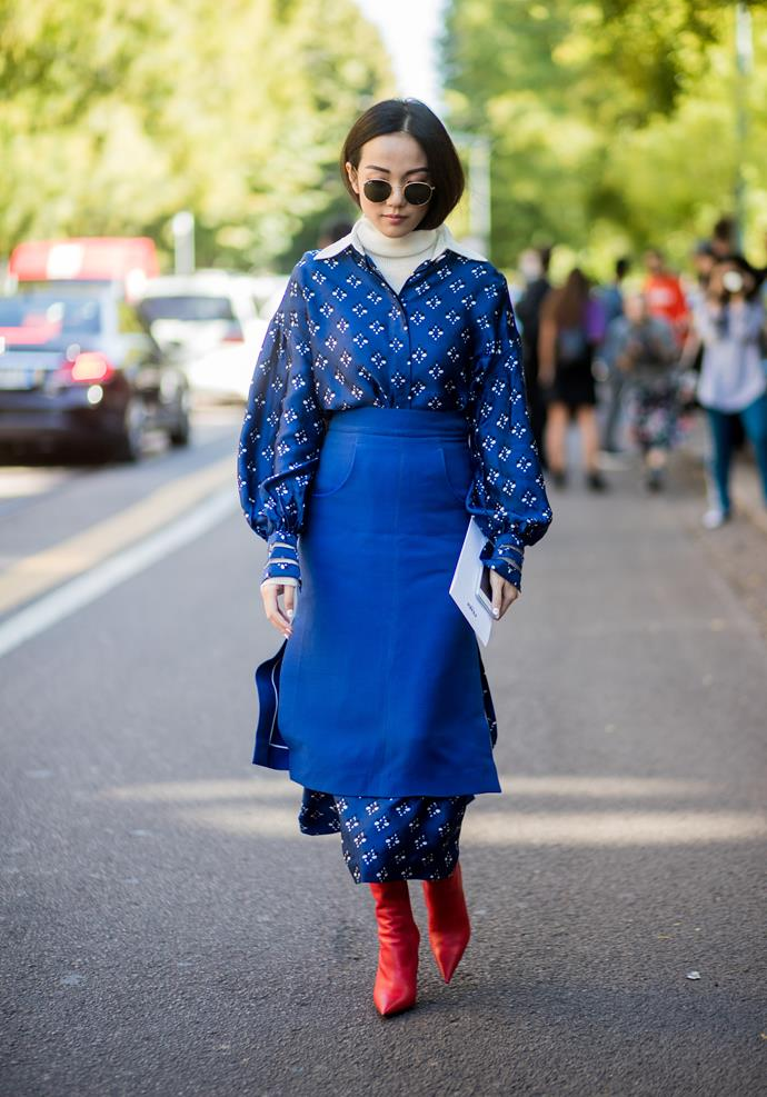 ***Add a skirt***<br><br> On their own, silk dresses and midi skirts aren't inherently warm, but together? We're feeling toasty. Go the whole nine yards like Yoyo Cao and add a wool turtleneck and leather boots, too.