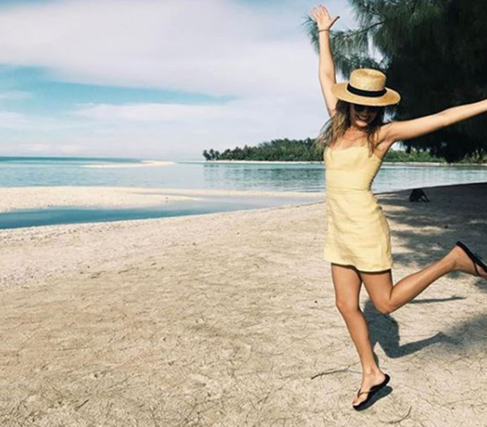 **April 2017:** Robbie's sunny yellow mini dress and classic boater might have been more smart casual than your average beachwear, but her thongs were about as low-key as you can get. (Image: Instagram)