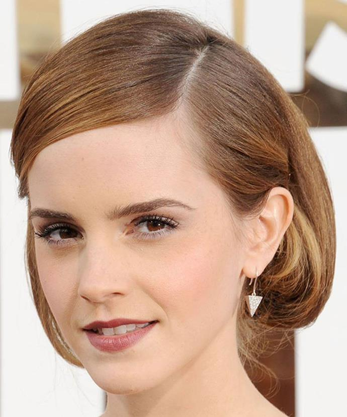 At the LA premiere of <em>This Is The End</em>, Emma opted for understated makeup to complement her outfit. Slicked locks were pinned behind the ears into a cute bob, showcasing her earrings while a matte plum lip adds a touch of sophistication to a sexy ensemble.