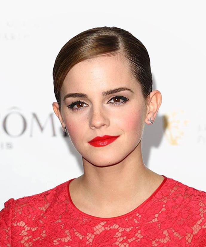 Emma oozes sophisticated elegance at a British Academy Film Awards party. Hosted by Lancôme, Emma's red lip is paired with lashings of black mascara and thick winged liner. Her look is complemented with a deep side-part and sleek hair.